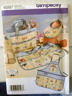 Simplicity 4597 - DIY Garden Accessories - Apron, Half-Apron, Sun Visor, Garden Tote - Also Good for Sewing Projects For Kids, Sewing For Kids, Sewing Crafts, Sewing Ideas, Craft Patterns, Sewing Patterns Free, Garden Bags, Garden Ideas, Coat Pattern Sewing