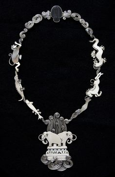 Necklace | Ahlene Welsh. 'Intelligent Design, 2005'. Sterling silver, trilobite This is awesome.