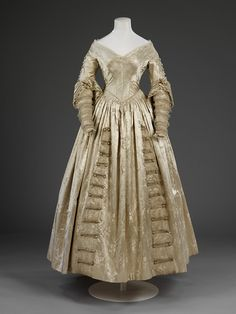 Wedding dress, England, 1841, figured silk satin with net and lace trimming. VandA.