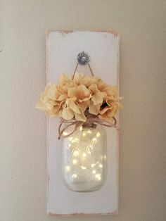 This is my take on a farmhouse chic wall sconce. It is so simple and shabby but at the same time very elegant. It measures 14 long and 5.5 wide, it includes one hanging mason jar with a string of fairy lights. Jar is pint size. The jar has been frosted to give the lights a