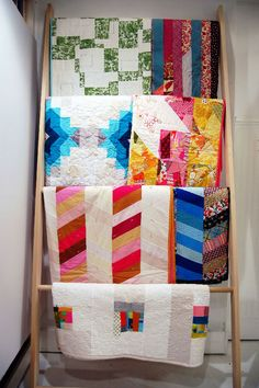 Easy instructions to make a quilt or blanket ladder to display your favorite quilts and blankets when you're not using them!
