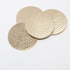 Image 4 of the product GOLDEN-COLOURED HAMMERED COASTERS (SET OF 4)