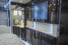 2016 New Prevost Emerald Class A in Florida FL.Recreational Vehicle, rv, This Emerald X3 is a complete Cherry Wood interior stained in a Dark Ebony, the furniture is covered in Platinum Leather all resting on a Sundance Smoke hardwood floor. The layout is a modified side aisle with a dual entry bathroom, a large angled shower and enormous rear walk in closet. The appliances and audio/video equipment are all state of the art with full iPad controlled Crestron Remote Control systems. COACH…