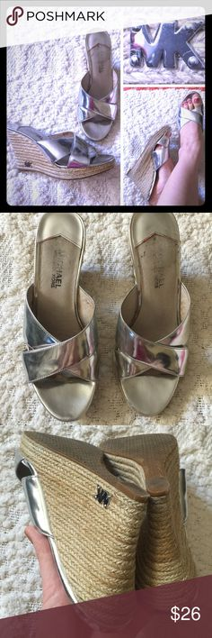 Michael Kors silver espadrille wedges Good used condition with signs of wear and some scratches on the upper edges on the heels. Hence the lower price. MICHAEL Michael Kors Shoes Wedges