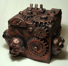 ceramic steampunk box made from slab tiles put together with a midge lodge of objects carved and attached to walls
