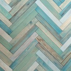 Our signature floor makes quite the statement - it's actually stained wood in a herringbone pattern.
