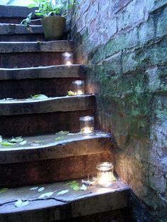Another way of using glass jam jars with tea lights as pretty lighting in the garden; pop one on each step to illuminate stairs beautifully.