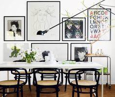 Garfisk designstudio210 // framed wall art collage, swing arm lighting, white dining table & black chairs #homedecor #interiordesign #diningroom