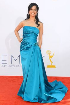 The Good Wife star Archie Panjabi stood out in a bright teal Randi Rahm gown.