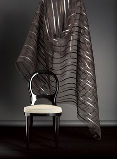 YPSILON by Ulf Moritz - Transparent fabric with vertical stripes made of fine sequin foil, inserted into stitched pleats.
