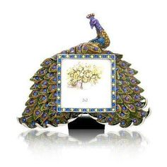 Peacock Crystal Studded Photo Frame, 2x2 inches by Welforth, http://www.amazon.com/dp/B004SZH7TA/ref=cm_sw_r_pi_dp_vmTNqb0Z2208F