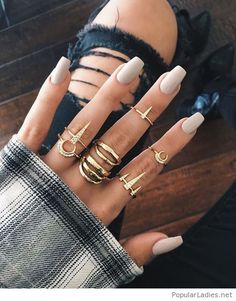 Nice grey nails with many gold rings