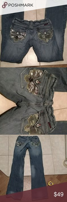 Miss me jeans Vintage miss me jeans with camouflage back pockets. One is all glittered up and the other is not. Very nice contrast. 33 inch inseam with a little wear on bottom and some wear throughout. No stains or holes. Rise is 7 inches and waist flat measures 15 inches. Marked as a size 28 but runs small so I marked these as a 27 Miss Me Jeans Boot Cut