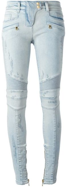 Balmain biker jeans : Light blue stretch cotton biker jeans from Balmain featuring a concealed fastening, a waistband with belt loops, front pockets, back pockets, ribbed details, side zip fastenings, a stonewashed effect, distressed effects and a skinny fit.