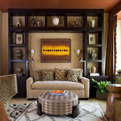 this contemporary living space manages to incorporate bold black accents without overdoing it. Artful shelves, lined with simple displays, contribute to the gallery vibe.