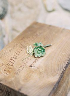 A succulent boutonniere Photography by jessicalorren.com