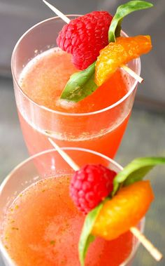 Raspberry Champagne Sparklers    6 ounces raspberries  5 tablespoons fresh orange juice (I used Clementines)  1-2 tablespoons sugar (depending on tartness of raspberries)  2-3 large basil leaves, roughly chopped  Champagne or sparkling wine