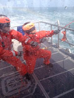 U.S. Coast Guard. Helo ops, a very wet training session.