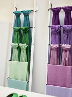 Shoppers looking for the perfect hue will be happy to find your products displayed by color. Here, HJALMAREN towel holders display scarves in a color gradient.