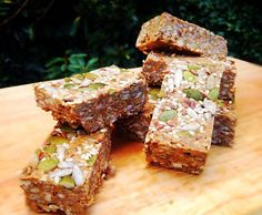 Raw Superseeded Protein Bars 1 cup almonds ½ cup cashews ½ cup walnuts ½ cup sesame seeds ½ cup pumpkin seeds ½ cup sunflower seeds ⅓ cup chia seeds 1/2 c fresh ground flaxseed 1 cup unsweetened coconut flakes  2 large scoops pea protein,  Pinch of Himalayan rock salt 1 cup (240g) 100% pure almond butter (or preferred 100% nut or seed butter – Tahini works well!) ½ c (100g) extra virgin coconut oil 2 tsp vanilla extract 1 tsp almond extract 1 tsp ground cinnamon 20- 40 drops liquid stevia