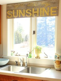 Turn a sign made from old barn wood and stenciled with happy song lyrics into a nontraditional valance that will brighten your day as much as the sunlight streaming in. Get the tutorial via At Home on the Bay ...