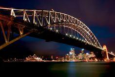 The Bridge sparkles against the backdrop of the Sydney skyline.
