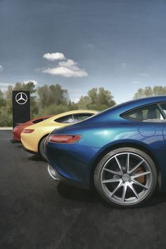 A colourful lineup of Mercedes-Benz AMG GTs.