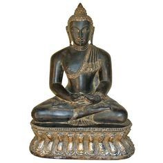 This seated Buddha carved out of black stone, is in dhyana mudra or a meditative state. With an antique finish, it is perfect for your study or meditation room.