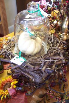 Crow's nest with bell cloche and pumpkin