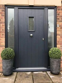 This kind of solid entry doors is a very inspiring and high-quality idea Cottage Front Doors, Grey Front Doors, Front Door Porch, House Front Door, House With Porch, House Entrance, Garage Doors Uk, Modern Garage Doors, Garage Door Styles
