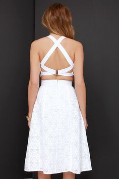 """You can relax knowing you're rockin' an on-point ensemble with the Piece and Harmony Ivory Two-Piece Dress! This puckered woven crop top with a tantalizing texture, and darted accents, is complemented by stretchy elastic trim that meets at a sliding, shiny gold closure at back. The matching midi-length skirt adds a classic touch with its banded waist, and asymmetrical box pleats. Skirt has hidden back zipper. Fully lined in stretch knit. Small top measures 13.5"""" long. Small botto..."""