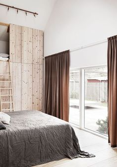 plywood storage in a Scandinavian home in the countryside   BODIE and FOU