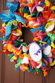 A Birthday Wreath. Who wouldn't want to see this on their front door????