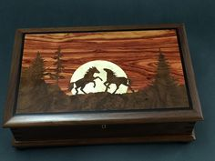 This is another box from customer John Sincerbeaux, and features ourCB-303 butt hinges and JB-250 lid stay. Using walnut, tulipwood, and birdseye maple, as well as the lid design with the silhouetted horses and landscape, really make this project stand out!