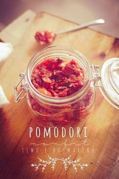 pomodori confit, contif tomatoes in a jar