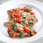 Grilled Bruschetta Chicken  (add 1/4 cup chopped onions and one clove of minced garlic*cooked* to the tomato/cheese/basil mixture)