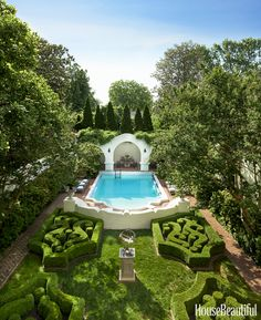 From their bedroom balcony, these homeowners have a view of the 1934 swimming pool, pool house, and stunning boxwood hedges.
