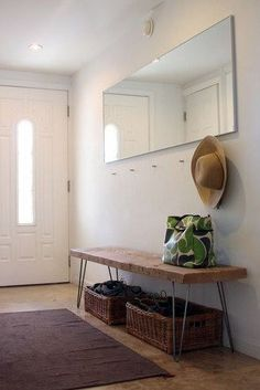 entryway idea - i think we'd need higher hooks for jackets, and i dunno about having the jackets right above the bench (we'll see), but i like the baskets under the bench and the long mirror/artwork that makes it feel like a dedicated space