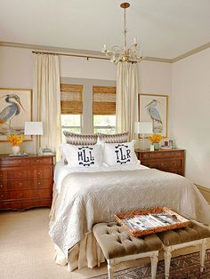 I love this room. The classy furnishings are surrounded by elegant touches, and beautiful symmetry; making it a relaxing haven.