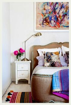 An Indian Summer ooooh cushions printed with jewels??? Die!  Love the massive abstract swirly colorful painting above bed also. Speaking of beds this is divine!!!