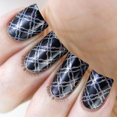 Holo nail art stamping over black nail polish using Delush Polish's Dazed & Enthused stamping plate.