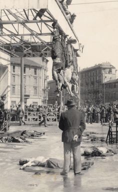 World War II. Benito Mussolini (1883-1945) and his mistress Claretta Petacci (1912-1945) hung by their feet in Piazzale Loreto in Milan (Italy). On April 1945.