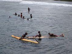 Local children having fun at Praia Sao João de Angolares on the southeast side of Sao Tome Island, São Tomé and Príncipe.