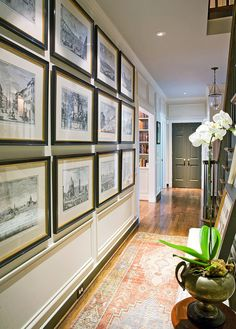 I love how they have used framed etchings in this area. The distance from crown molding and chair rail is the same distance and they used equal spacing around each frame. The etchings have similar themes and the pen/ink aspect will allow them to travel to any room and not disrupt the decor.