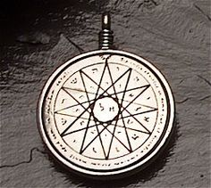 """Talisman of Uncanny Wisdom- Used by King Solomon for wisdom unequaled anywhere. It is said that King Solomon of Israel humbly prayed for the power of wisdom and was granted such by the Angel of the Lord, """"Homadiel."""" Our Talisman of Wisdom is affixed with the Seal of Mercury which is said to assist in gaining knowledge and understanding of all things. Frighteningly powerful. Excelsior Pewter with accent bead, 36"""" cord. Double-sided. 1 1/4"""" diameter."""