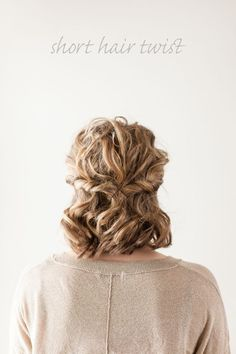 Gather a two-inch section of hair on one side of your head and twist around itself towards the back, securing with a bobby pin. Repeat this on the other side of your head, combining the two twists at the center of your head with pins.
