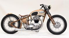 I love the overall classic style of this bobber.  Definitely something to keep in mind while working on my TR6R.  I really like the oil tank on this bike.