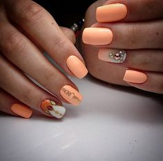 Matte Orange Studded Geometric Nail Art. Simple peach, base white, patterns of gold and punch on rhinestones will add glam to your nails.