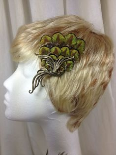 Baby peacock feather hair clip with copper pheonix bird on Etsy, $20.00