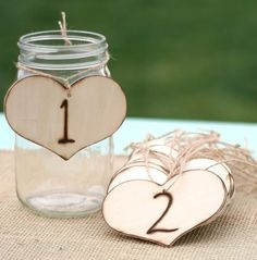 Tie numbers around your jars and use them as table numbers. Leave the tops off and supply guests with pens and paper to leave you good wishes and notes in the jar.    Photo courtesy Bragging Bags.
